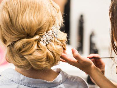 hair-stylist-makes-the-bride-before-a-wedding.jpg